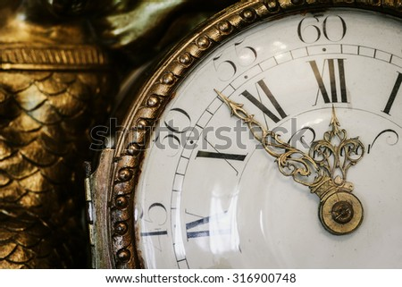 Antique clock with roman numerals in the classical style - stock photo