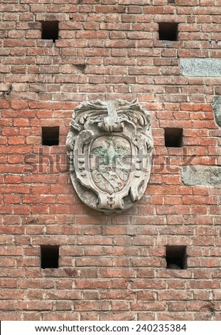 Antique coat of arms figure carved in stone outdoors - stock photo