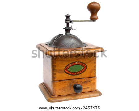 "Antique coffee grinder isolated on white (logo has been removed, remaining text says ""national product, trade mark"")"