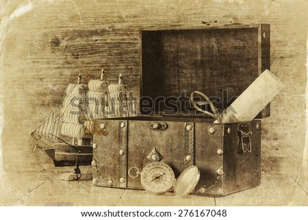 antique compass, manuscript, old vintage chest on wooden table.  black and white style old photo  - stock photo