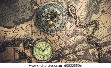 Antique compass necklace pocket watch pendant stock photo download antique compass necklace and pocket watch pendant on old world map gumiabroncs Images