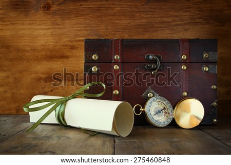 antique compass on wooden table  - stock photo