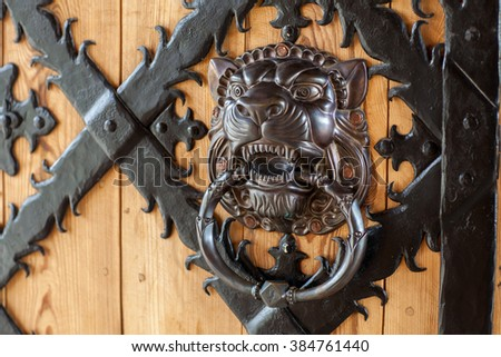 antique door handle in the form of a lion's head