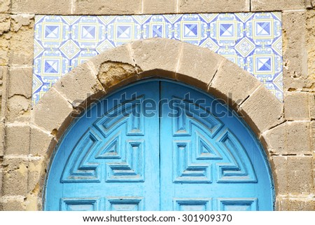 antique door in morocco africa blue wood and metal rusty - stock photo