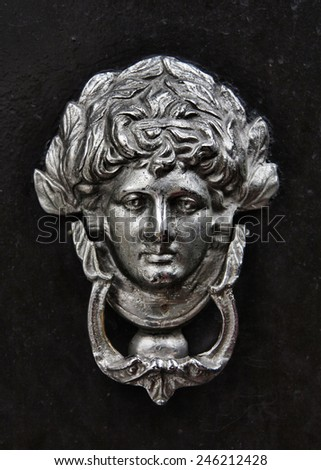 Antique door knocker - stock photo