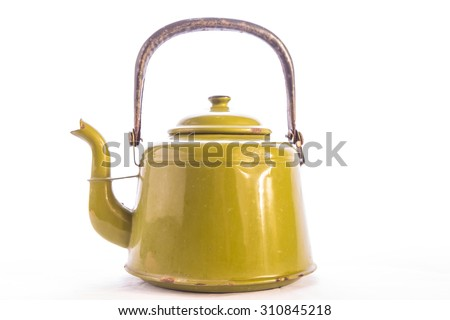 Antique enamelware teapot including dents and scratches and even some rust spots.  Horizontal format on white background with copy space. - stock photo