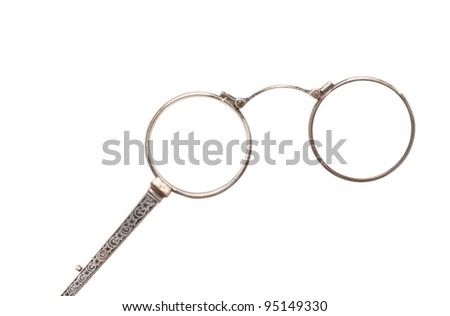 Antique eyeglasses in front of a white background - stock photo