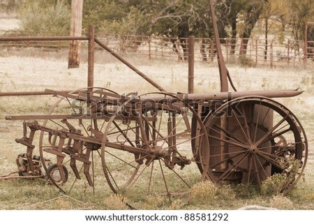 Antique farming equipment left on abandoned fields (done in sepia)