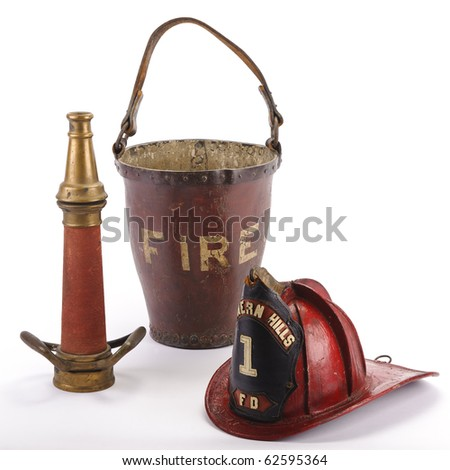 Antique fire equipment: (from L.) brass nozzle, leather fire bucket, and leather helmet