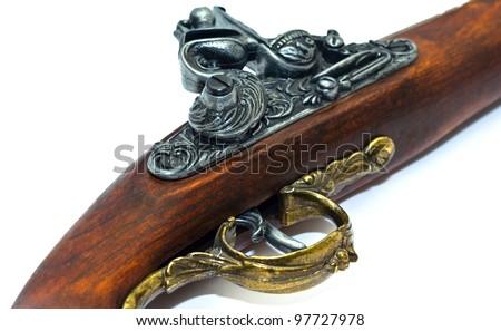Antique flintlock blunderbuss pistol detail, on white background. - stock photo