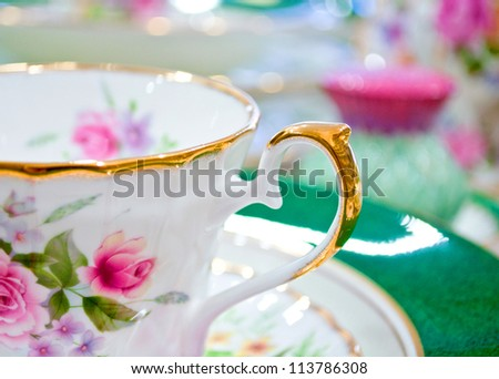 Antique floral tea set macro shot - stock photo