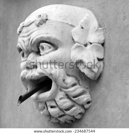 antique  fountain tap in Florence, Italy - stock photo