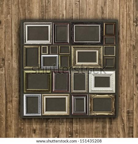 Antique frame on wood background - stock photo