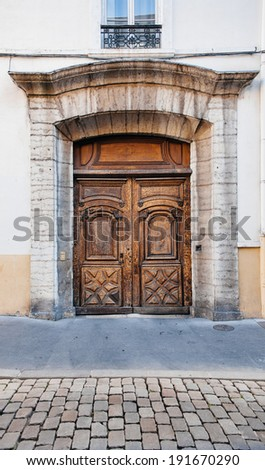 Antique french style wooden door in Lyon, France. beautiful handcrafted vintage decoration element. - stock photo