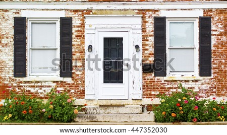 Antique Front Door Windows Shutters and Flower Bed in Columbus Ohio German Village - stock photo