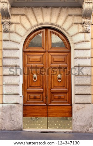 Antique front entrance wooden door with gold details