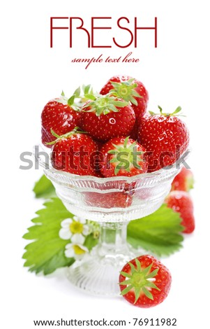 Antique glass filled with fresh tasty strawberries over white (with sample text) - stock photo