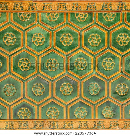 antique glazed ceramic  wall detail, fragment from  facade in Forbidden City in Beijing, China, Asia - stock photo