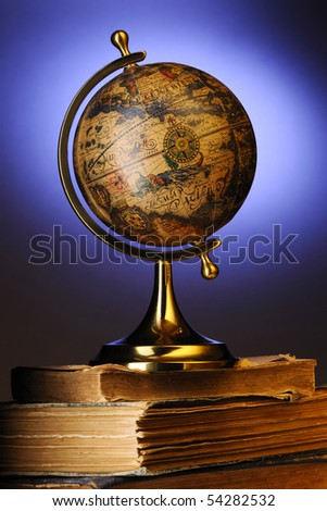 Antique globe on old books - stock photo