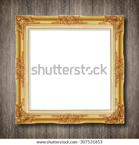 antique gold frame on wooden wall background