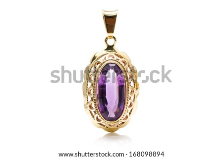 Antique gold pendant with an amethyst stone - stock photo