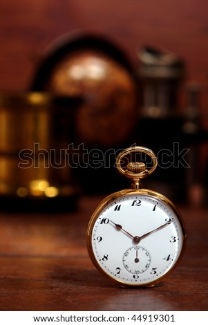 Antique gold pocket watch on a desk in an old curio and memorabilia shop