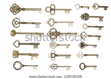 antique golden door keys isolated on white background
