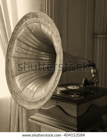 Antique gramophone (in sepia, vintage style) - stock photo