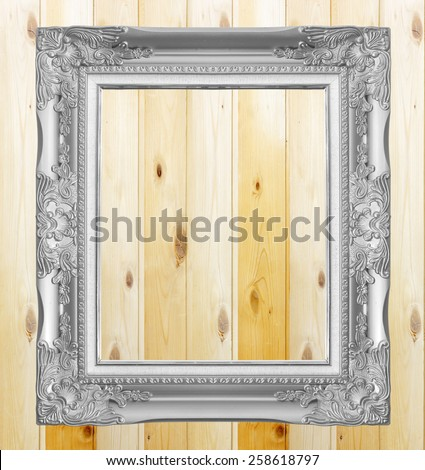 Antique gray frame on  wooden wall