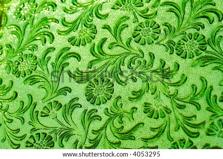 Antique green glass with flower patterns