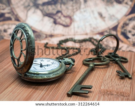Antique Grunge Pocket Watch Clock, Skeleton Keys On Wooden Table and Ancient Map Background.