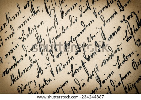 antique handwriting with a text in undefined language. manuscript. parchment. grunge paper background. retro style toned picture