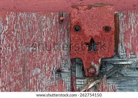 Antique Hinge with Star on Old Barn Door - stock photo