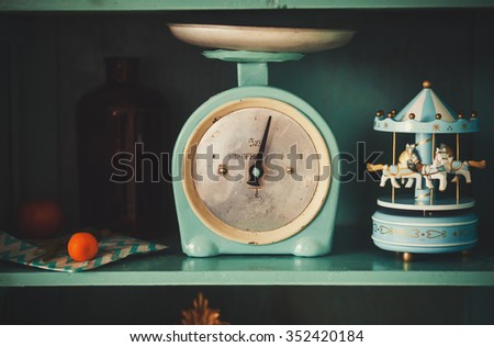antique kitchen-scales in the closet - stock photo