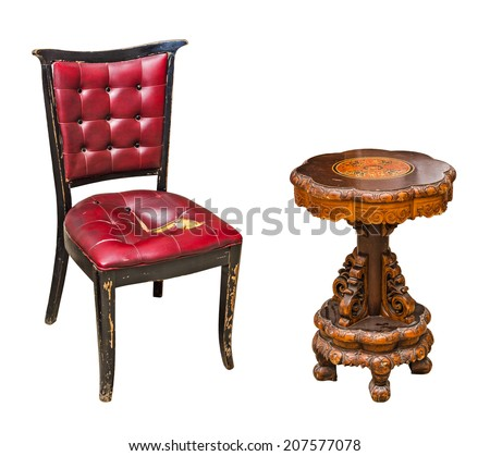 Antique leather chair and round wooden table isolated on white background - stock photo