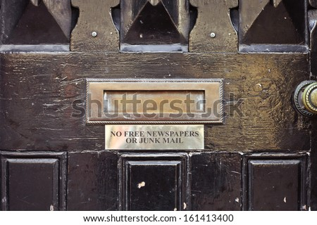 Antique letterbox with sign requesting no free or junk mail - stock photo