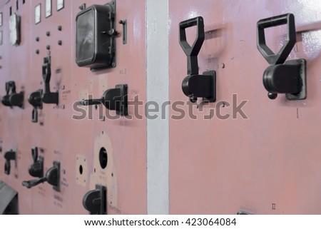 Antique leverage  switches on electric centrale - stock photo