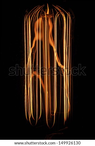 antique light bulb filament - stock photo