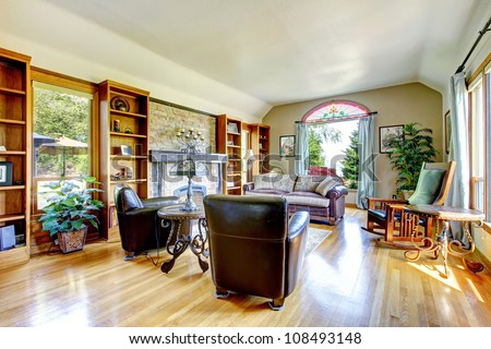Antique living room with fireplace and book shelves. - stock photo