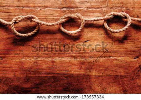 antique looking background with a rope with knots on wood