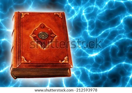 antique magic book - stock photo