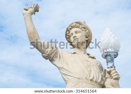Antique man statue in the Thai historical park. - stock photo