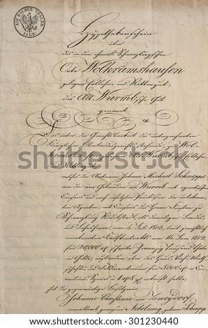 Antique manuscript with calligraphic handwritten text. Grunge vintage paper texture background - stock photo
