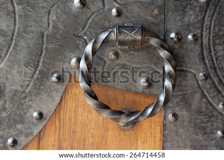 Antique metal door bell on wooden door - stock photo