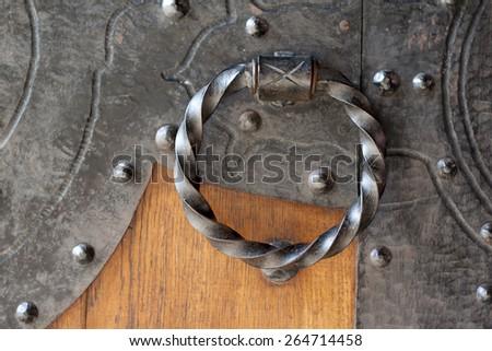 Antique metal door bell on wooden door - stock photo