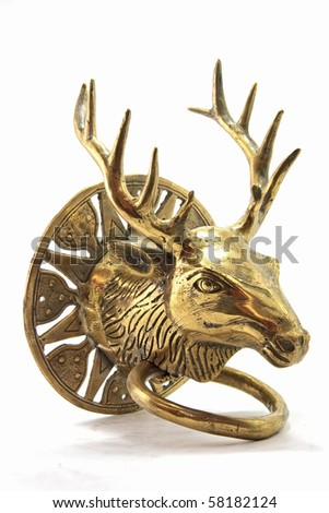 Antique metal door handle knocker in Deer Head Shape - stock photo