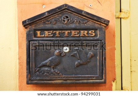 Antique metal mail box - stock photo