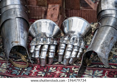 Antique metallic medieval armor gloves detail - stock photo