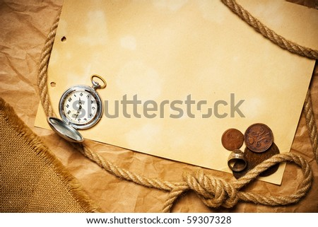 antique money with watch and rope on old yellow paper