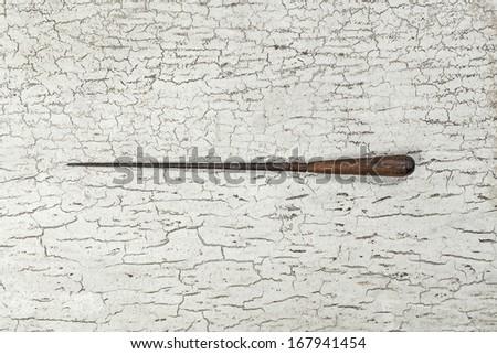 Antique needle carpenter tool (Still life) - stock photo